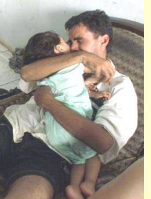 Sadeq Al Abodei with his daughter, Kauthar just days after the sinking of SIEVX